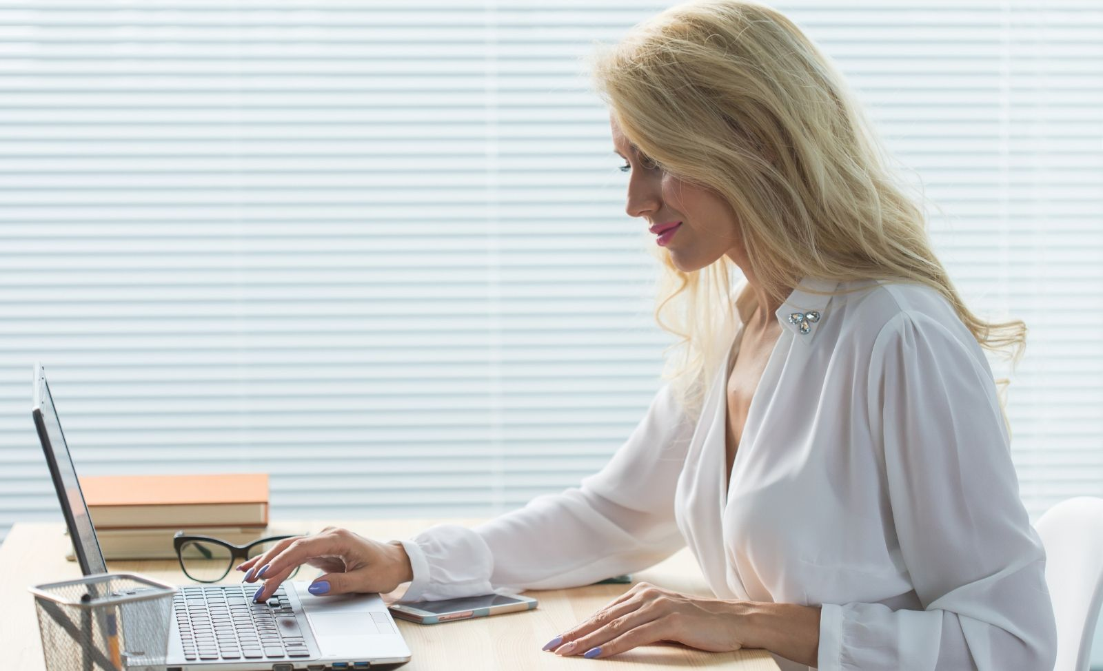 lady working at her desk on a laptop