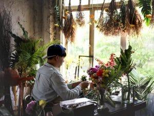 Flower shop business owner working service