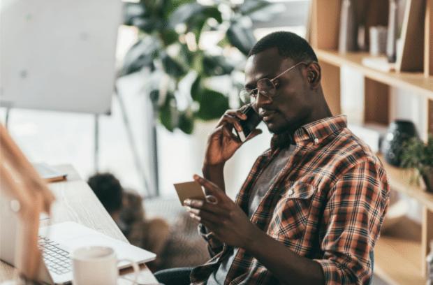 man calling bank regarding credit card problems