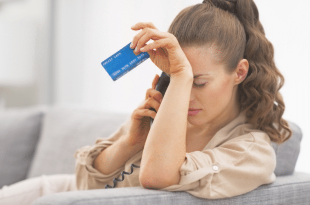 woman speaking with her bank regarding her credit card problems